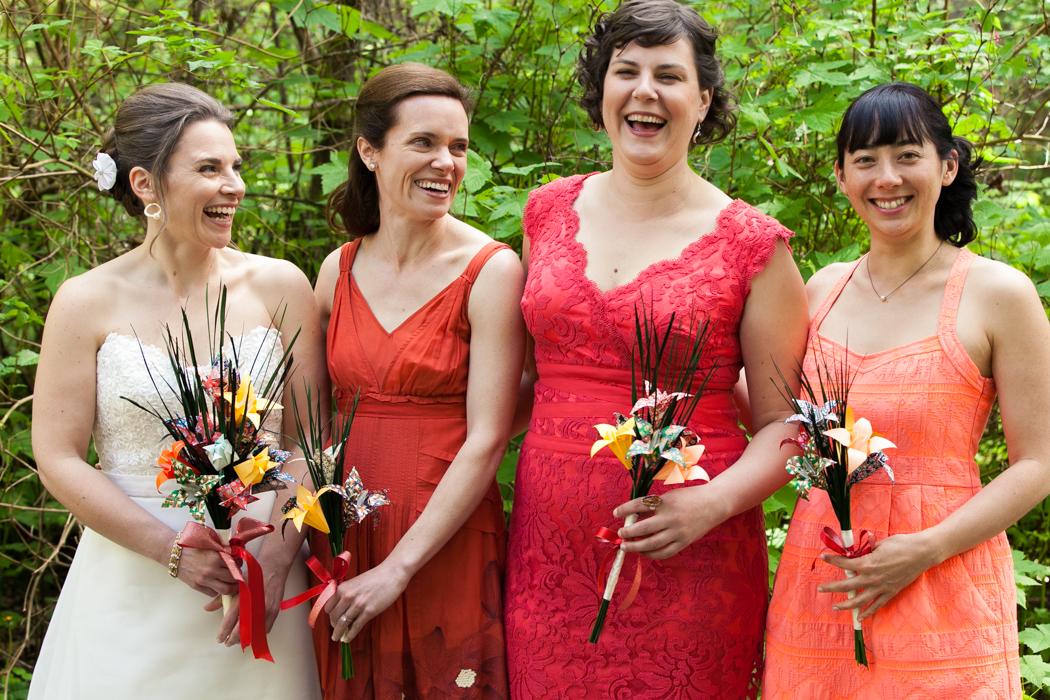 bridesmaids laughing orange bridesmaids dresses
