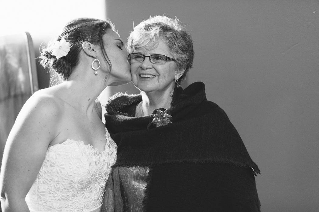 bride kissing her mom