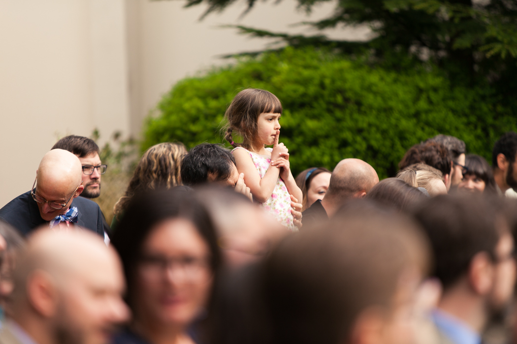 little girl sitting at ceremony