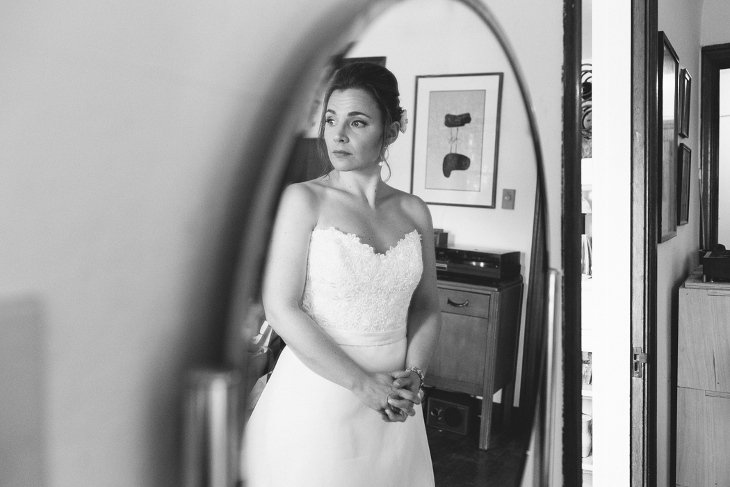 bride looking in a mirror getting ready