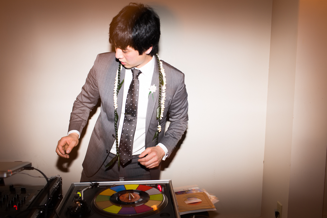 groom at the dj table