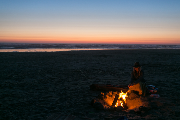 making s'mores in seaside oregon on the beach at sunset