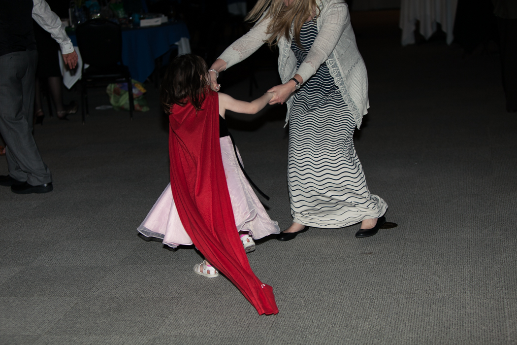 kid dancing in a red cape