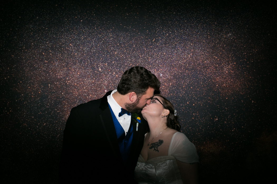 galaxy wall bride and groom kissing