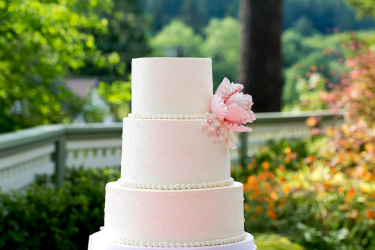 classic three tier pink and white wedding cake