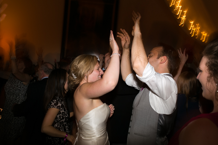 bride and groom high-five