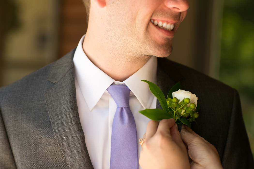 groom Boutonniere being pinned