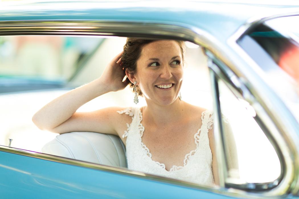 bride in classic turquoise car