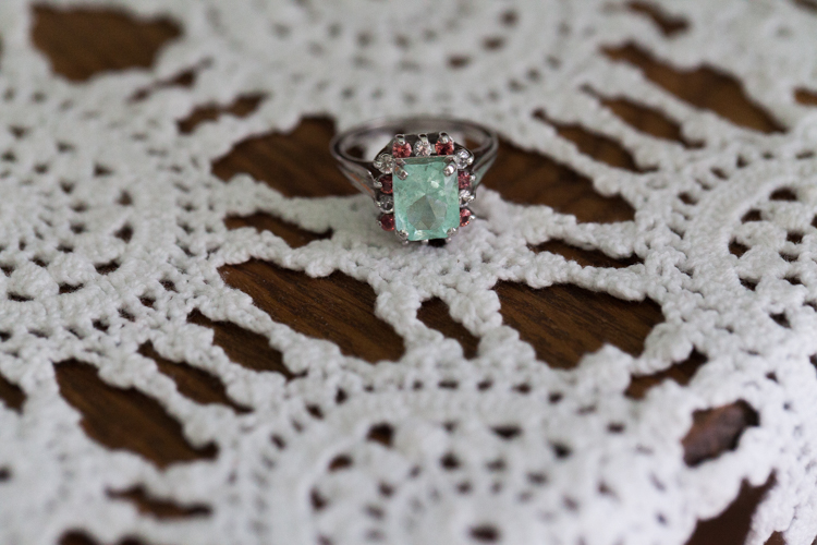 emerald diamond ring surrounded with rubies and diamonds