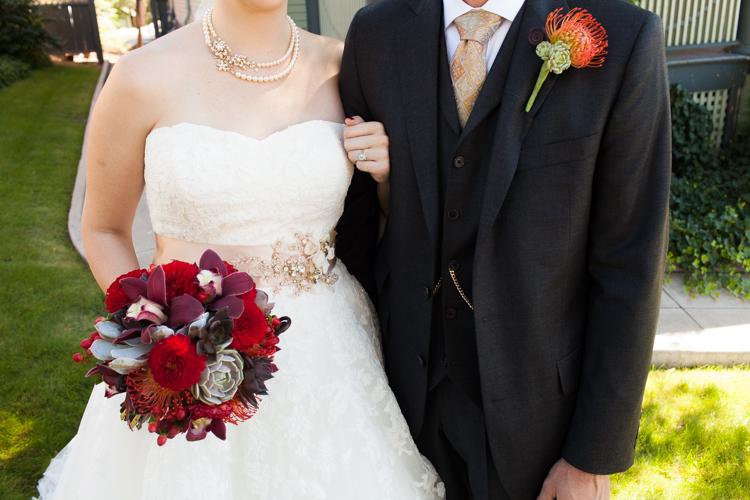 red bouquet bride