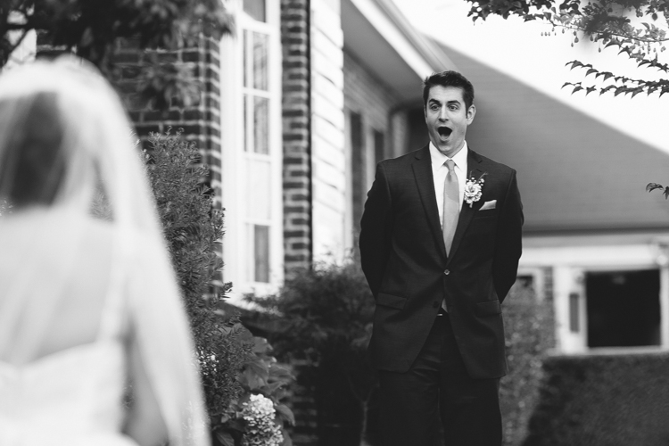 The groom is surprised and excited upon seeing his bride during the First Look.