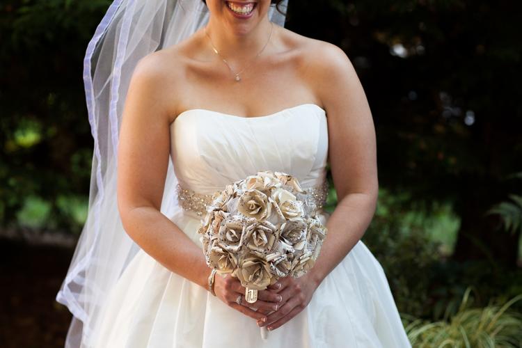 Closeup of bride holding paper flower wedding bouquet