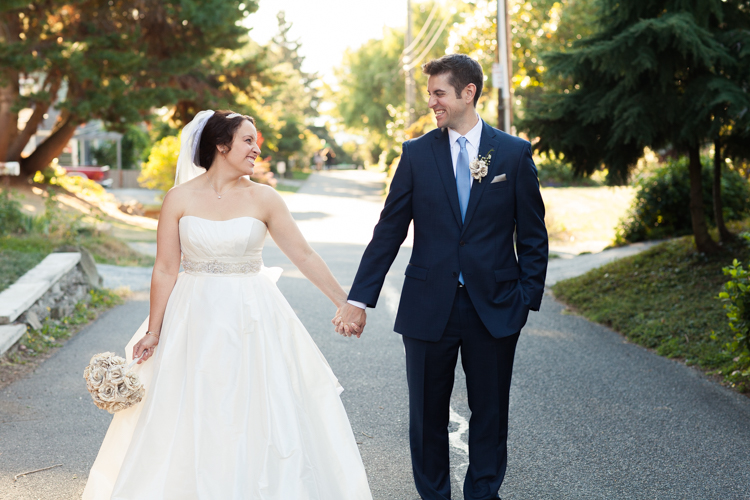 Bride and groom holding hands during formals in West Seattle wedding.