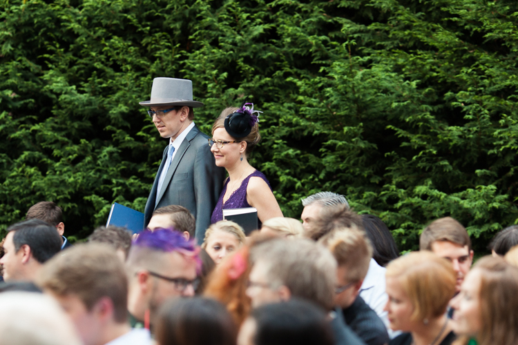Wedding officiants wearing top hats and hairpieces.
