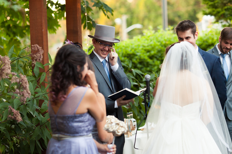 The officiant at this west seattle wedding wipes away a tear