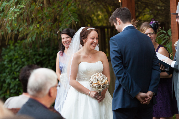 Bride laughs during wedding ceremony.