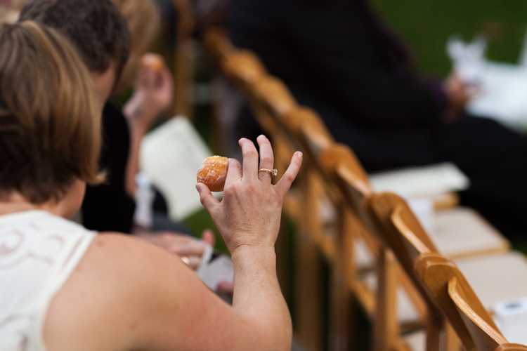 Donut holes used for toasting during wedding ceremony.