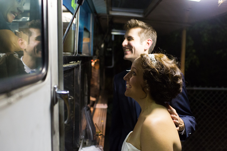 Bride and groom visit taco truck caterers during their wedding reception at the hall at fauntleroy.