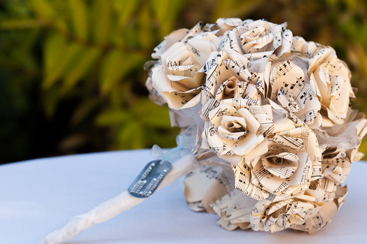 Paper flower bridal bouquet made of music sheets including grandfather's dog tag.