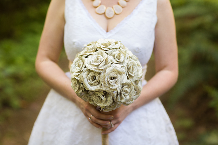 Paper flower bridal bouquet and vintage dress with chunky necklace.
