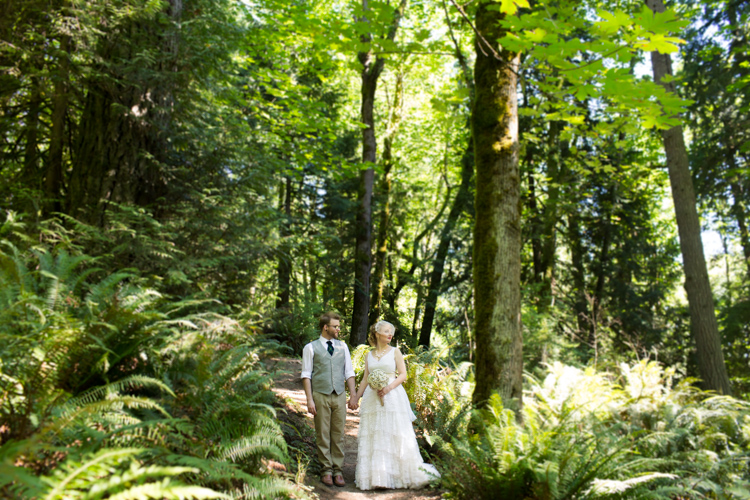 Bride and groom stand together during formals in the woods in Western Washington.