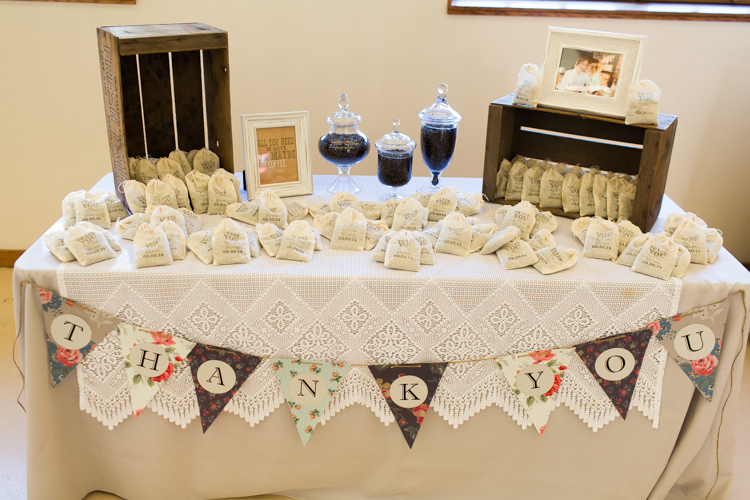 Wedding favor table including custom coffee bean bags.
