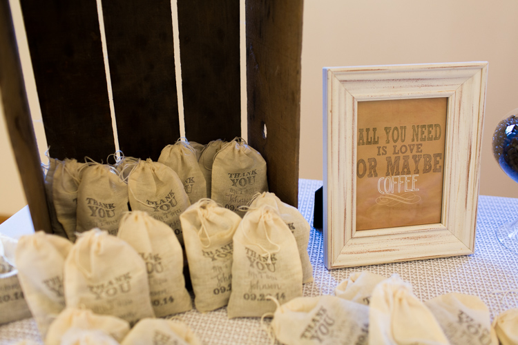 Customized bags of coffee beans for wedding favors.