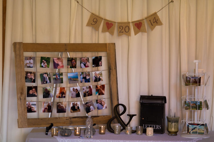 Wedding guestbook table including candid photos of bride and groom and vintage details. 2
