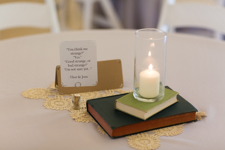 Karenajamie pickering barn wedding marvel avengers themed wedding reception centerpieces quotes books candles junglespirit