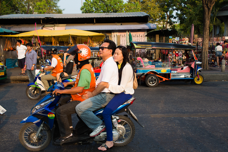 bangkok motorbike with three passengers