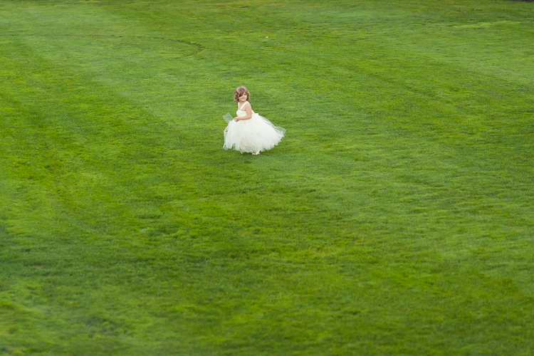 bridesmaid running in a field