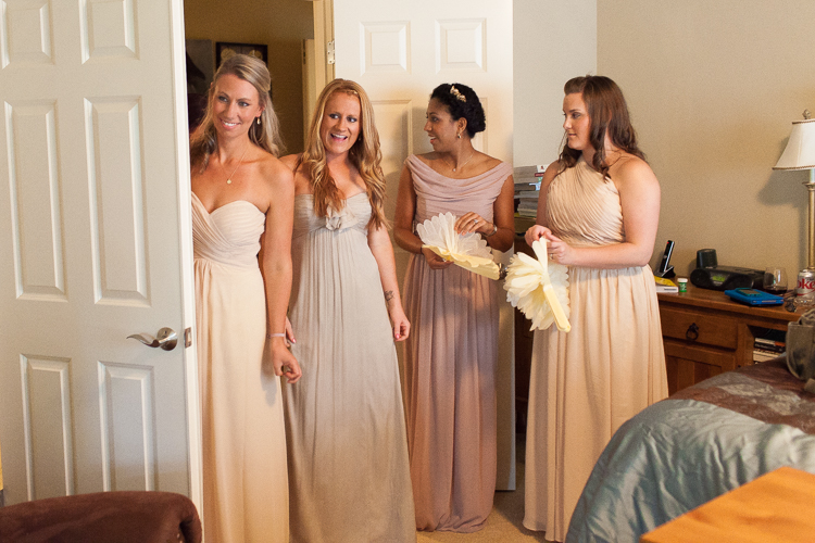 bridesmaids watching bride getting ready