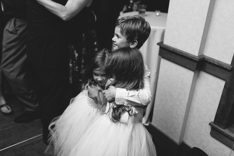 flower girl and ring bearer dancing