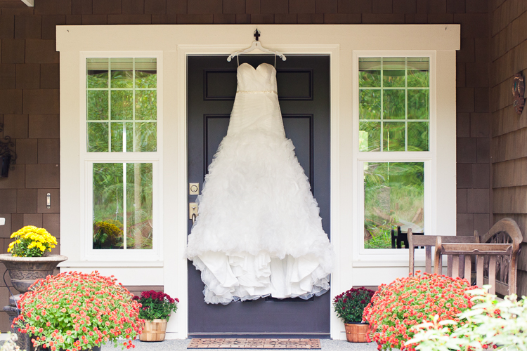 wedding dress hanging on door of childhood home