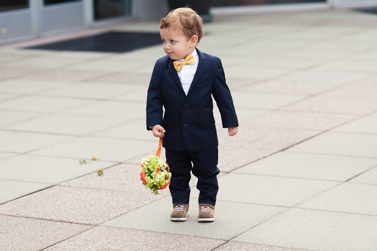 adorable ring bearer holding ring basket