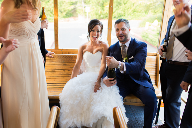 bride and groom toasting on trolley