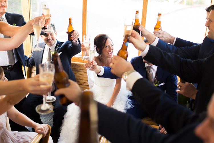 bridal party toasting on a trolley