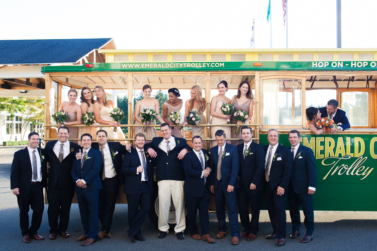 fun wedding party in front of a trolley