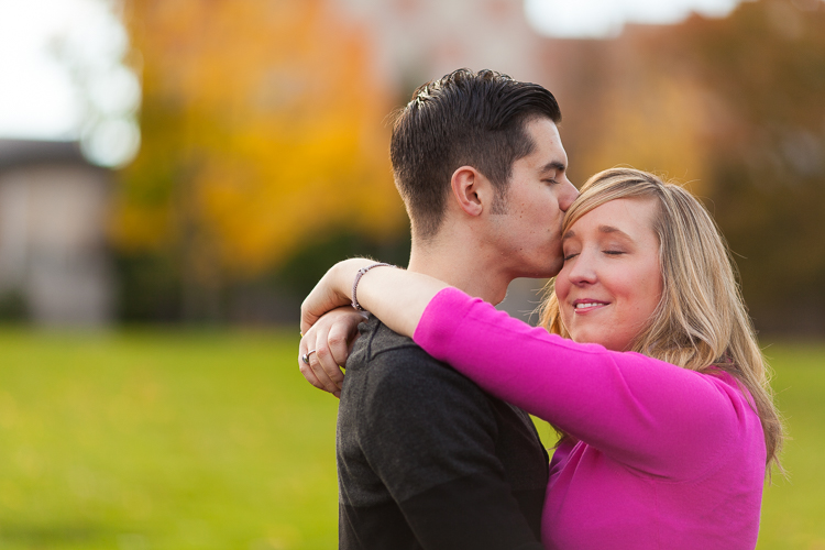 groom kisses bride during engagement session