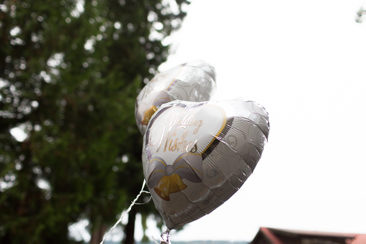 mylar balloons are used to direct guests to wedding ceremony.