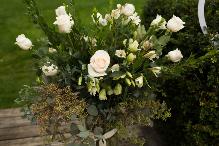 White roses in floral display.
