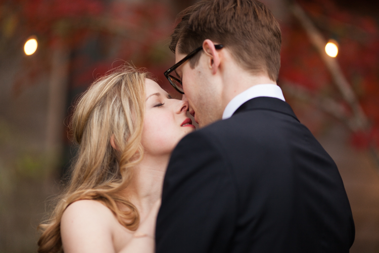 A romantic kiss between the bride and groom.