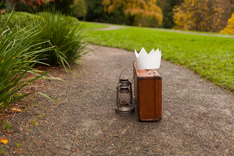 suitcase and paper crown styled engagement session