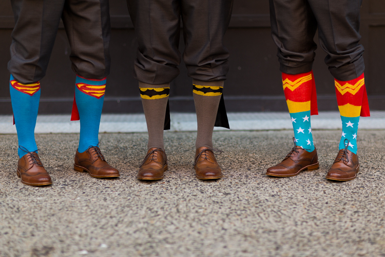 groomsman in superhero socks