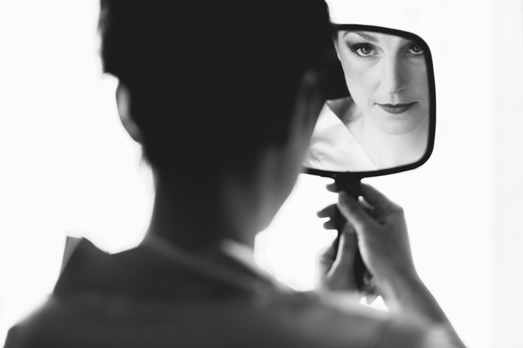 bride looking in the mirror getting ready