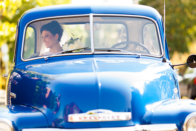 bride in blue pick up truck