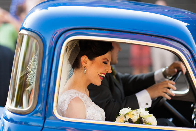 bride laughing in vintage truck