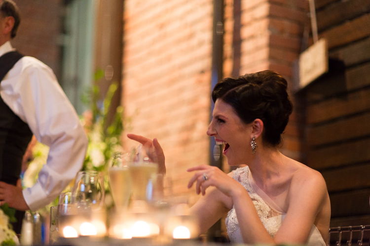 bride laughing at toasts