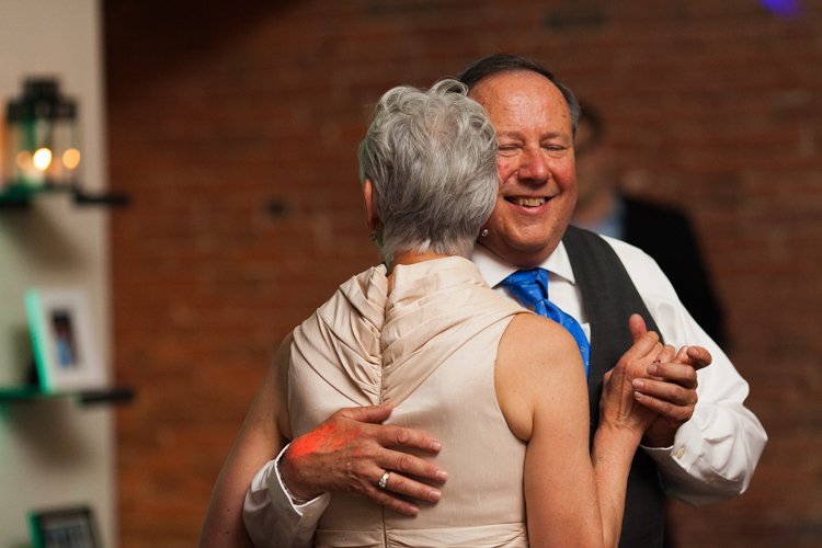 father and mother of the bride dancing